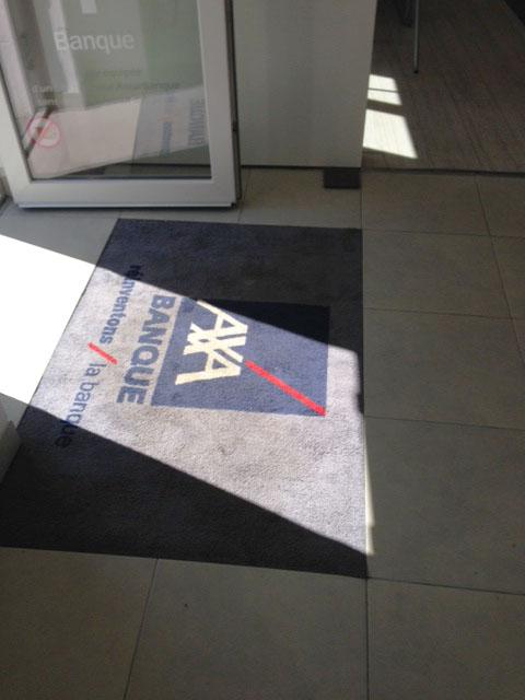 Tapis personnalisé pour l'agence AXA Caron (France)